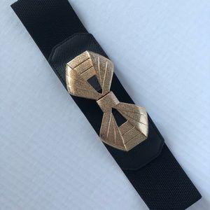 Wide black elastic accent belt gold bow clasp